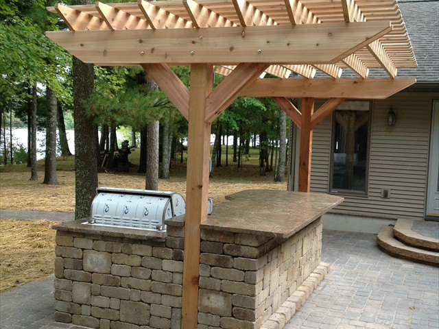 Lake House:  Close-up of outdoor kitchen and pergola.