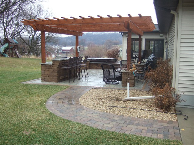 Outdoor kitchen and pergola with walkway