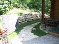 Cabin walkway and limestone retaining wall
