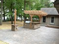Lake House after installation of patio, outdoor kitchen and pergola.